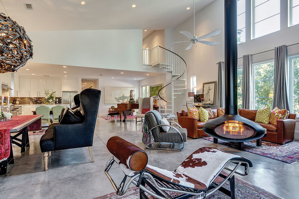 Indoor open fireplace and lounge chairs