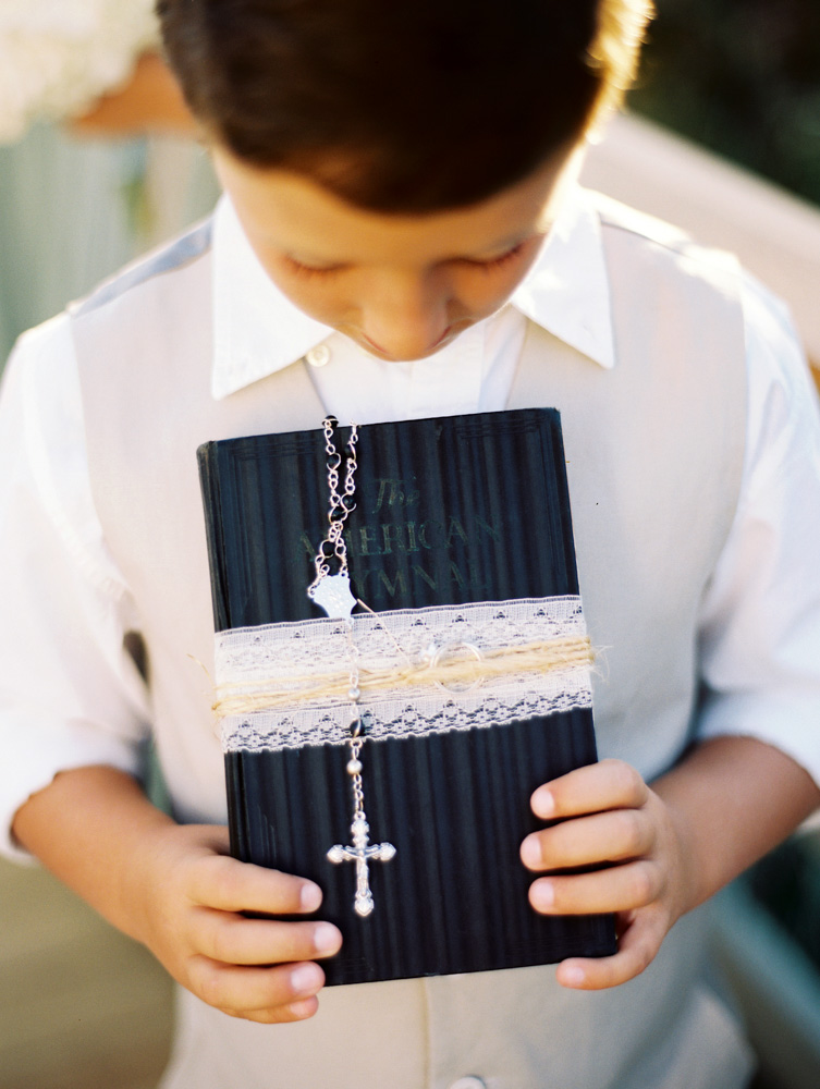 Jennifer and Jimmy Goff ring bearer holding bible with rosery