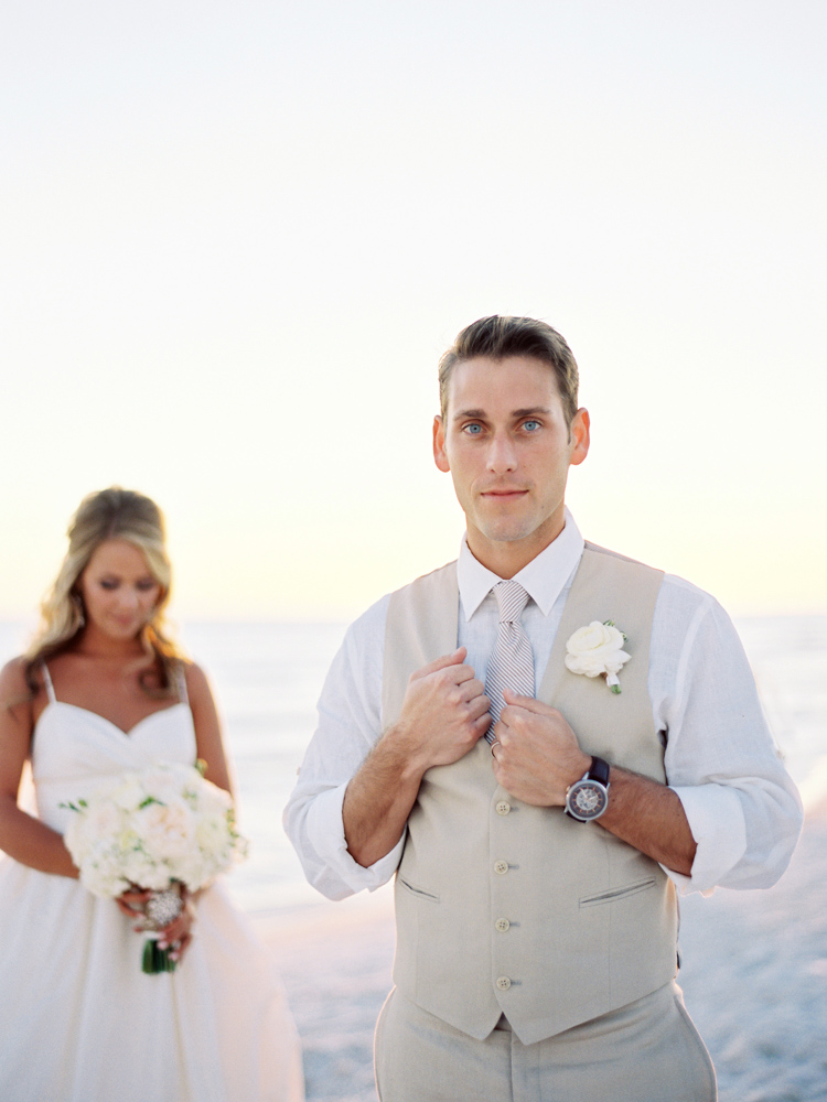 Bride and groom, Jennifer and Jimmy Goff, posing on the beach