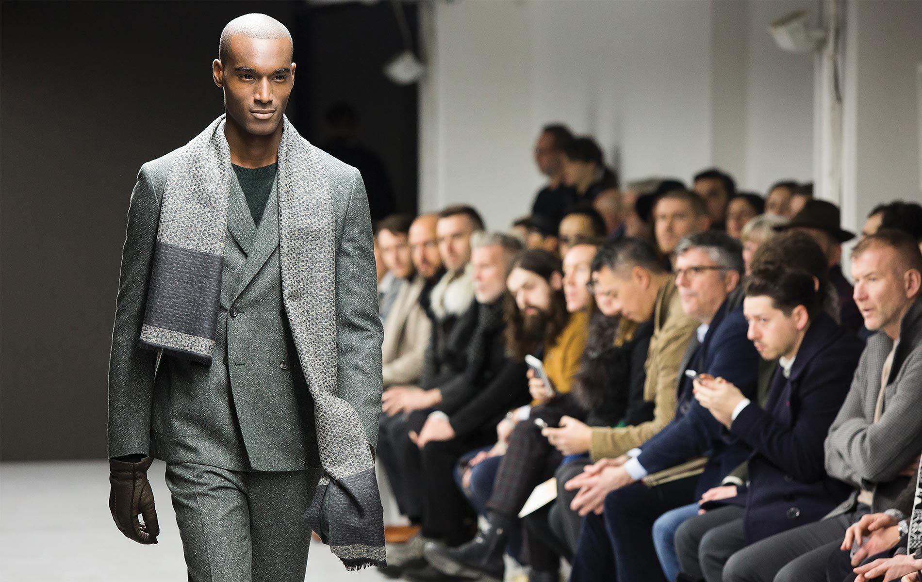 Fashion menswear model walking down the catwalk at London's Fashion Week Fall Winter 2015