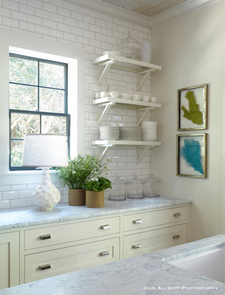 White kitchen with small paintings