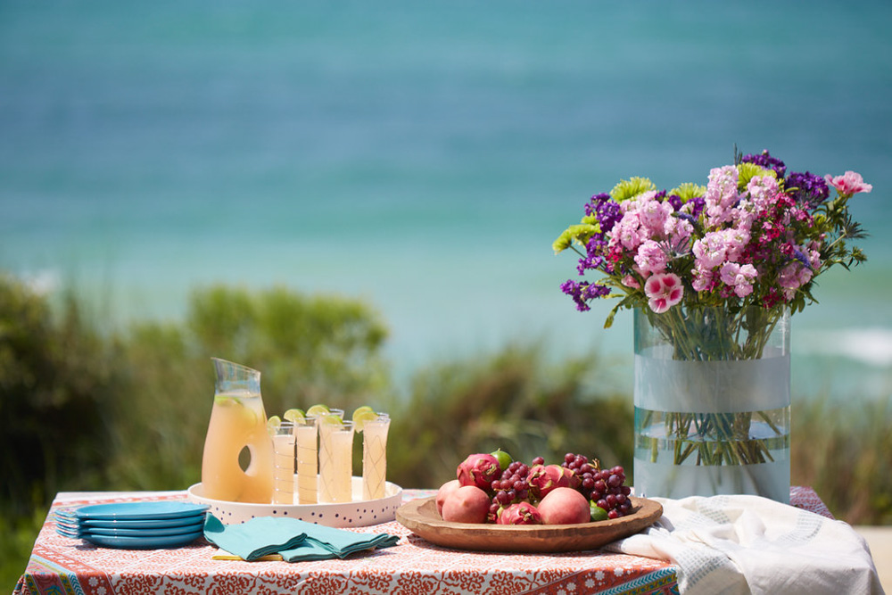 Beach with flowers and fruit