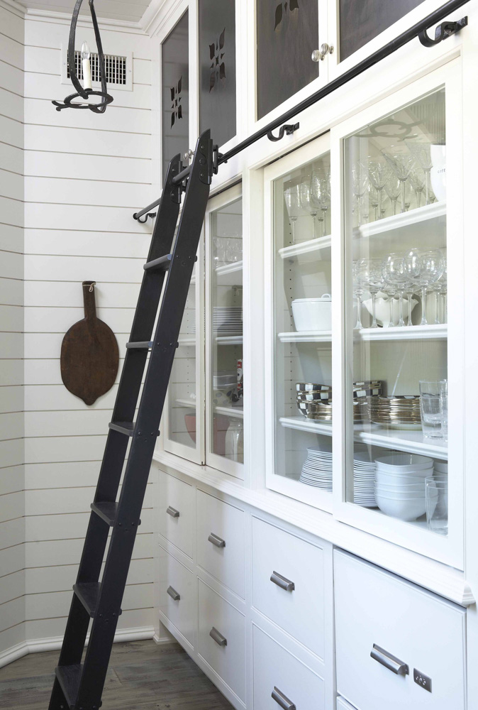 White cabinets with black sliding ladder