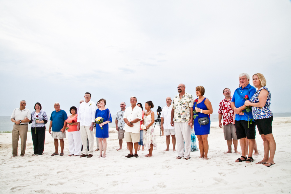 Couples renewing their vows on the beach