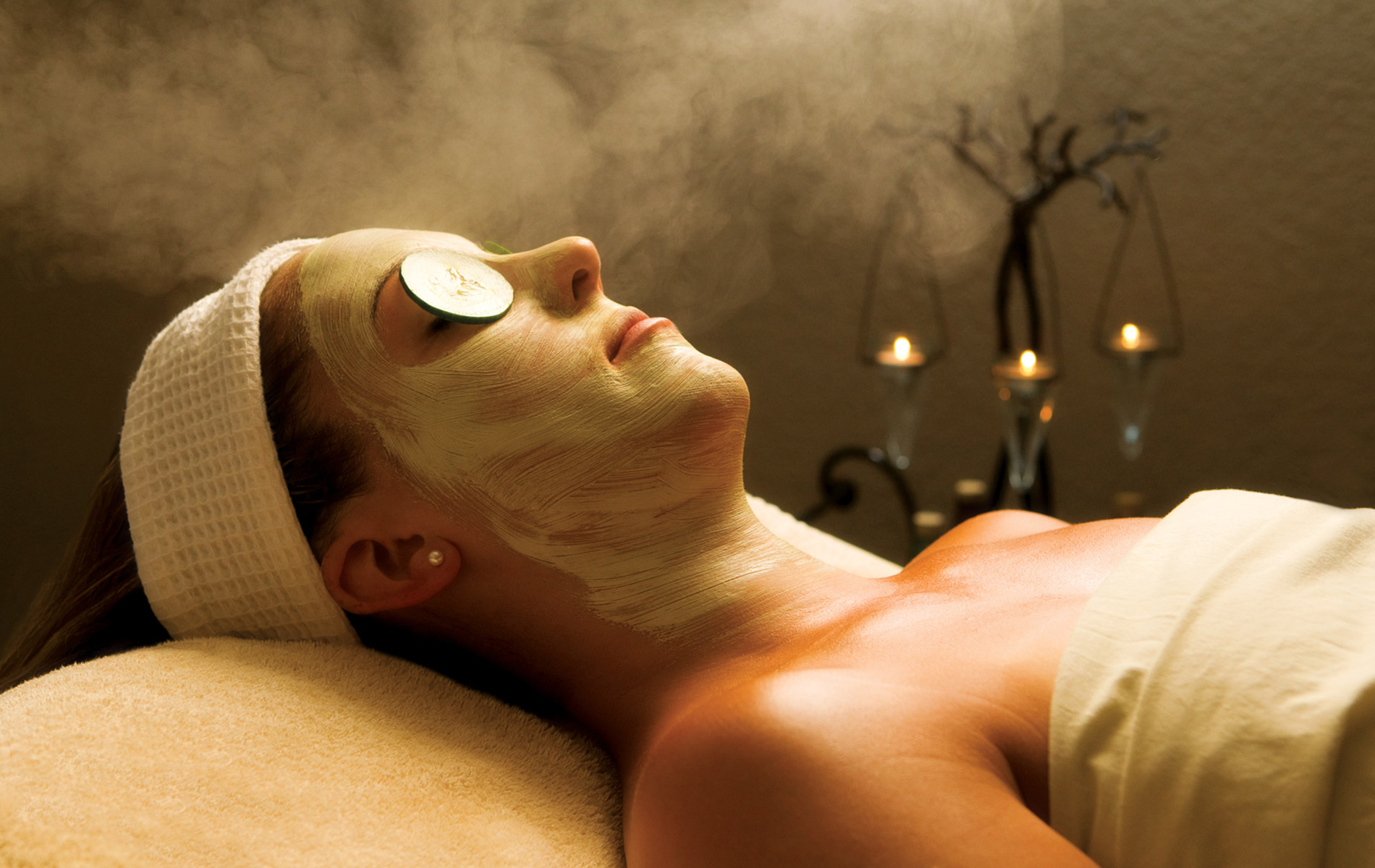 Woman relaxing in spa with facemask