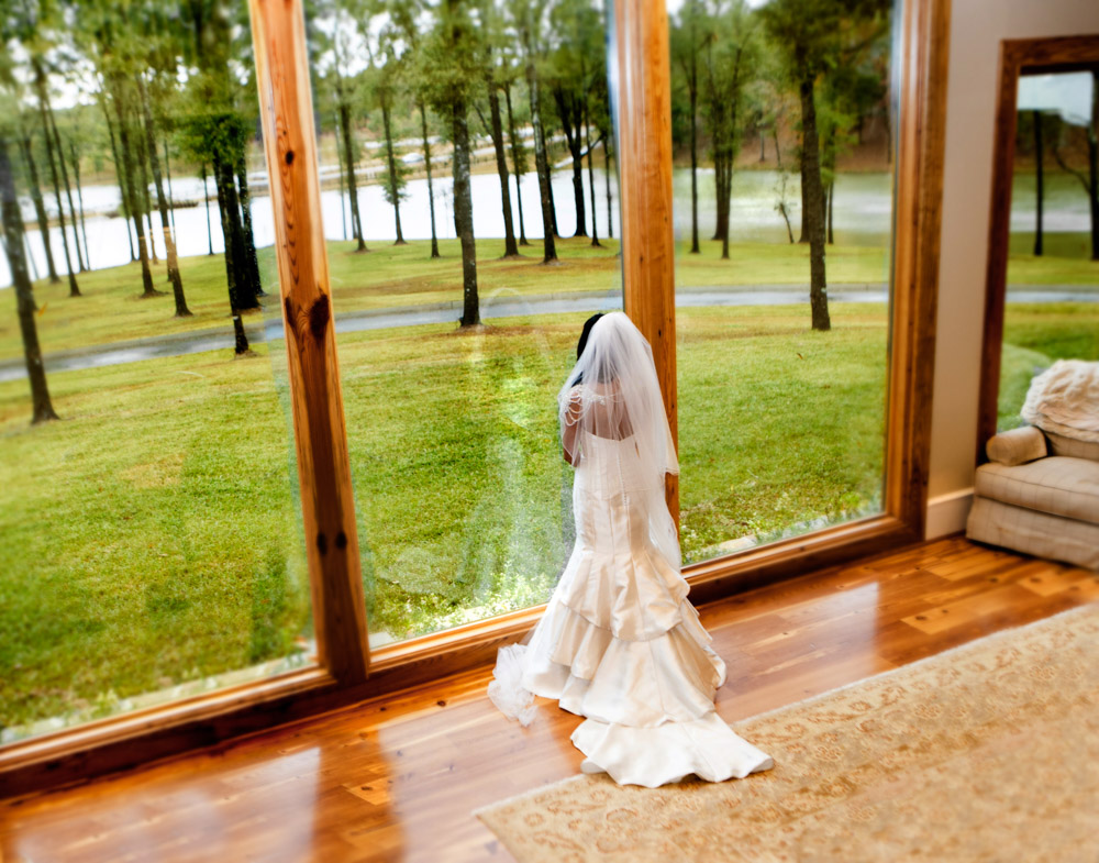 Bride looking out to lake