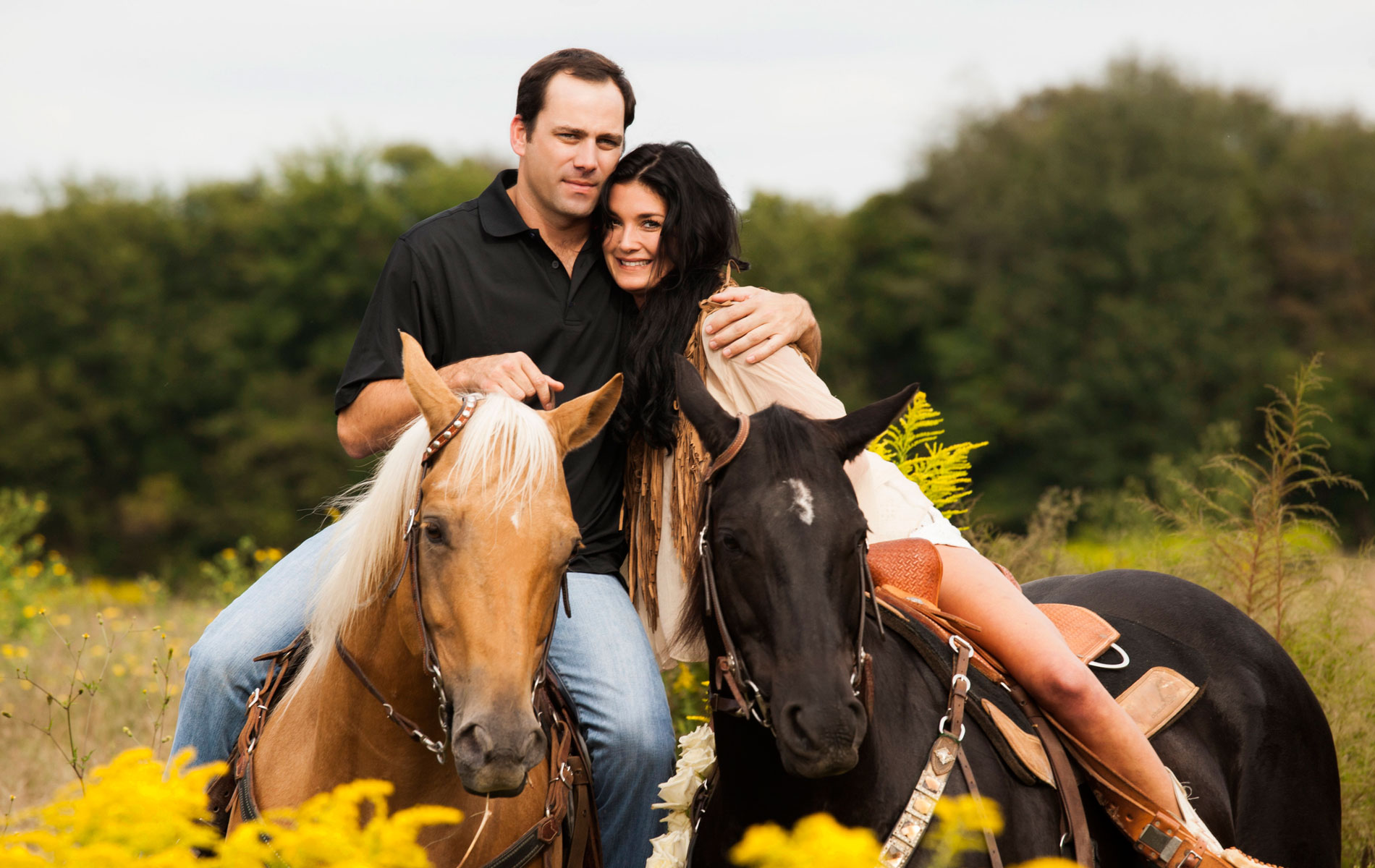 Newlyweds riding horses