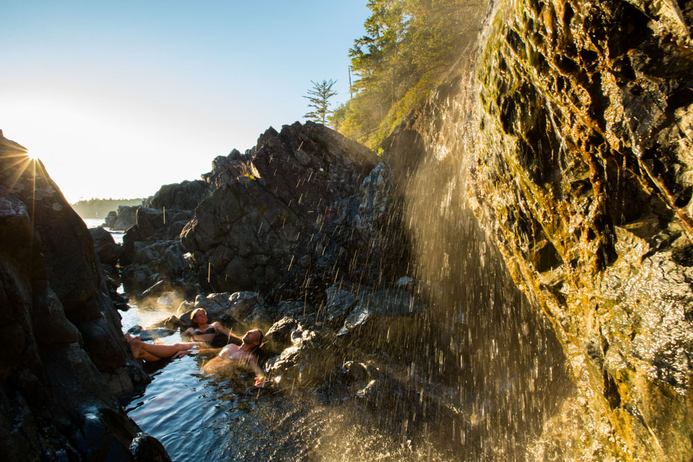 Vacationers lounging in natural hot springs in Vancouver Island, Canada