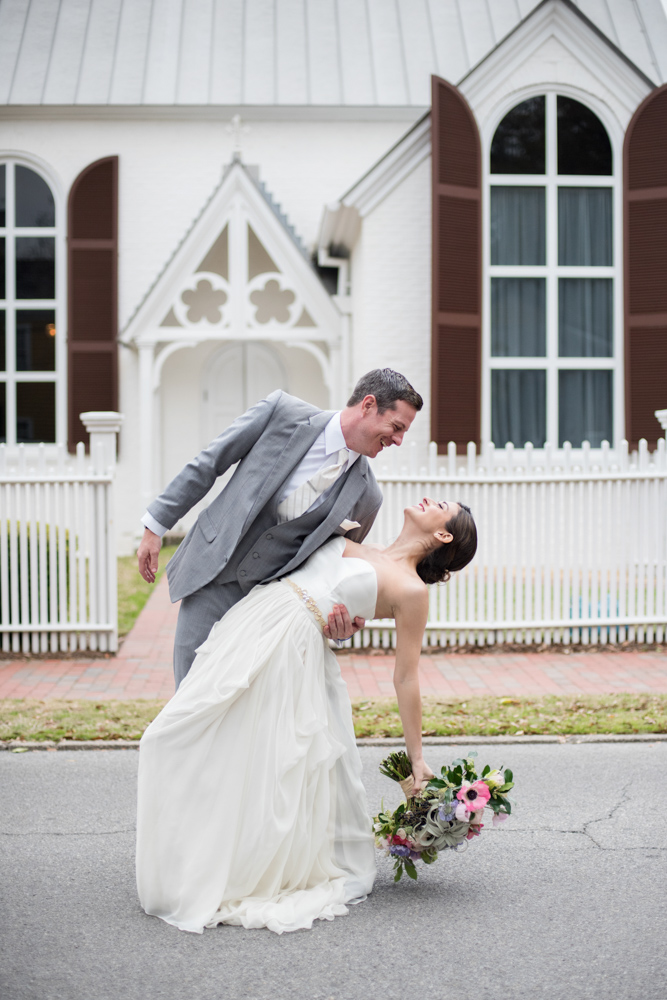 Wedding Event Specialists bride and groom in front of church. Photo by Melissa Wilson Photography