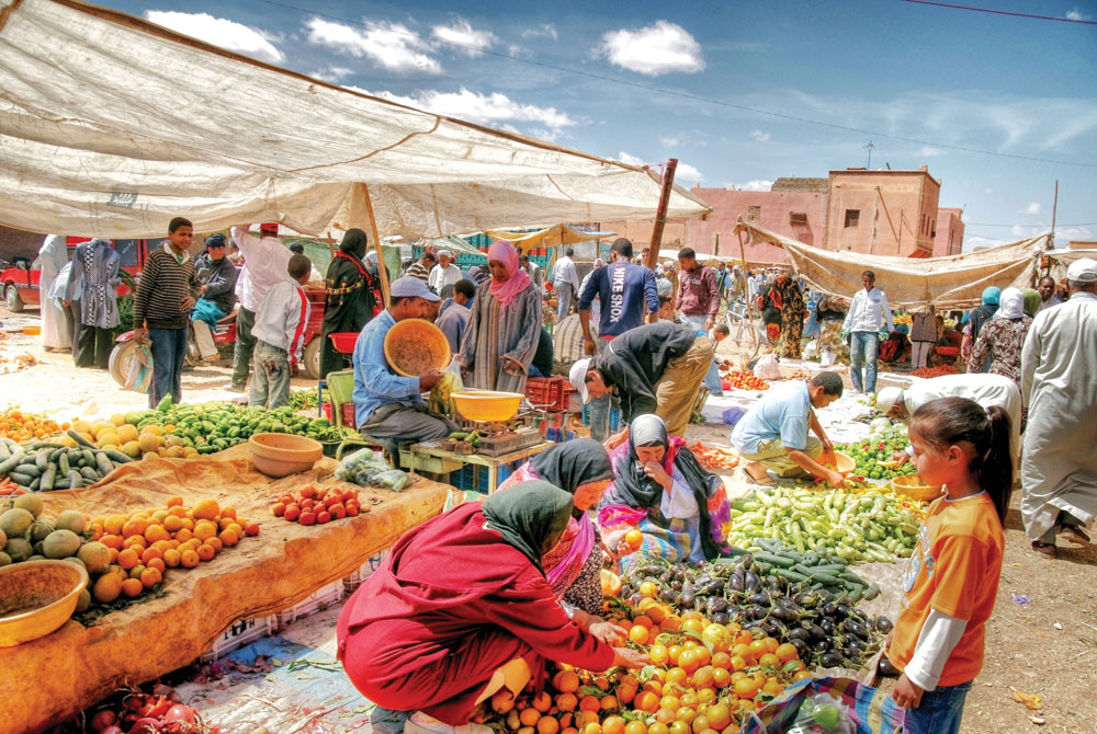 People shopping in an outdoor Moroccan market