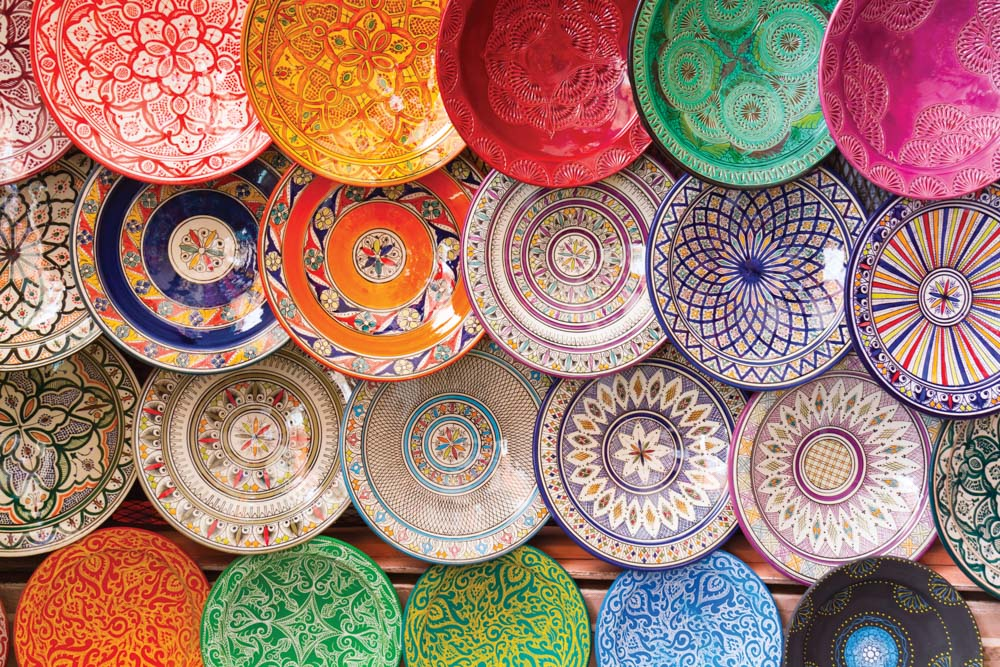 Colorful plates on display in Moroccan market