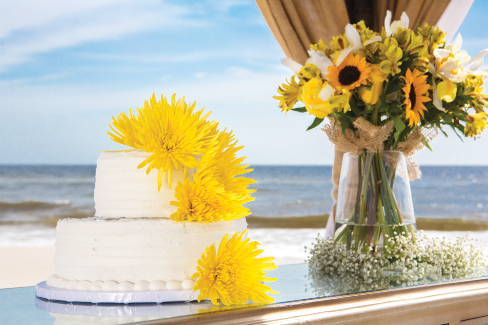 Wedding cake and flowers at Mexico Beach wedding photo shoot, photos by Romona Robbins