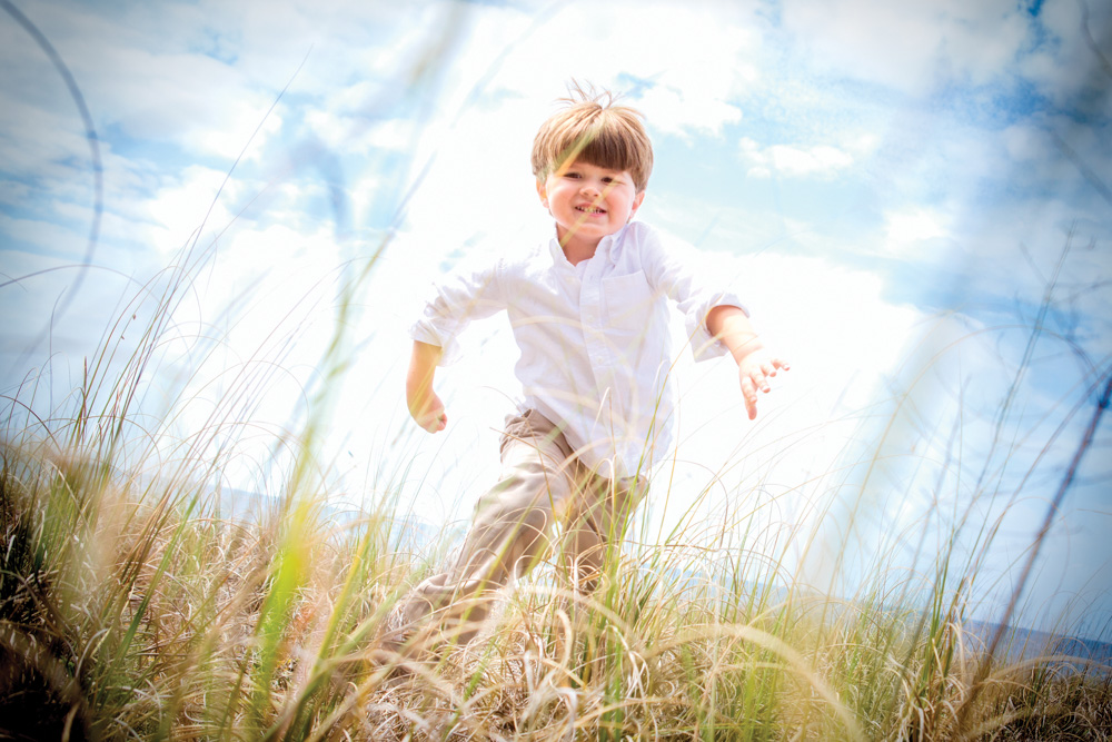 Little boy running at Mexico Beach wedding photo shoot, photos by Romona Robbins