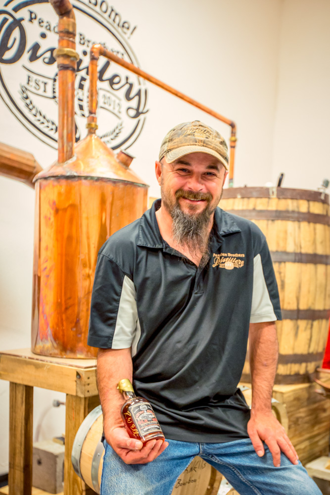 Tyler Peaden, owner and partner of Peaden Brothers Distillery