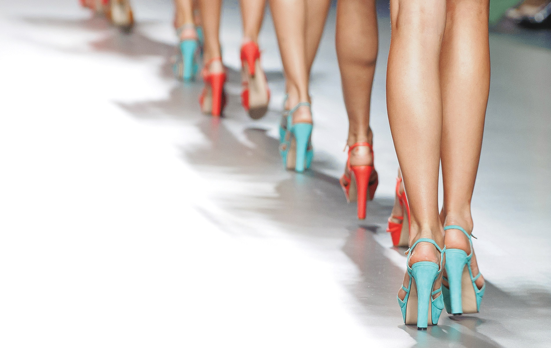 Bright colored heels lineup walking down South Walton Fashion Week Runway 2015