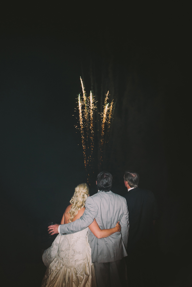Bride and groom watching fireworks at Kimberly and Clain Zimmerman beach wedding