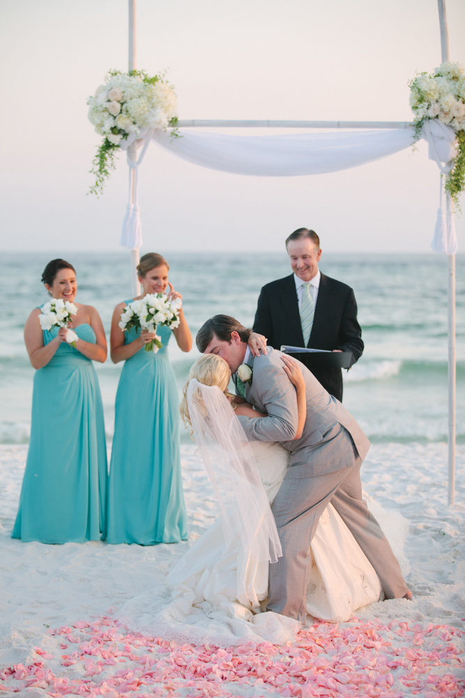 Man kissing bride at Kimberly and Clain Zimmerman beach wedding