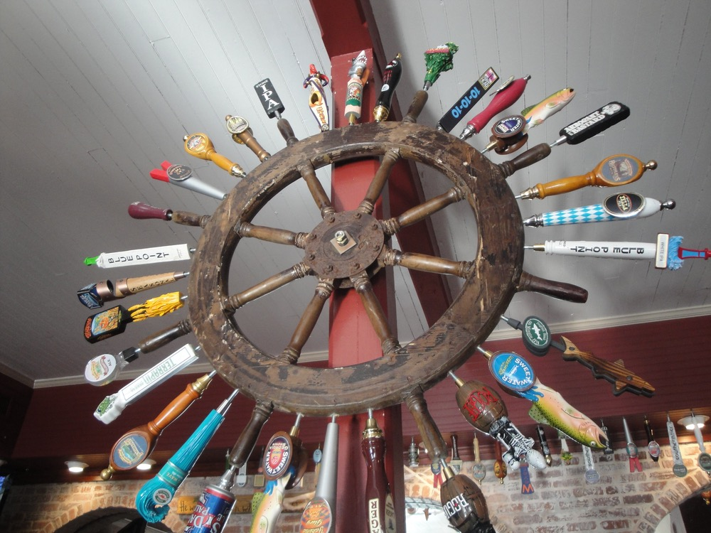 "Authentic ship's wheel with ""draft picks"" awaiting their next turn"