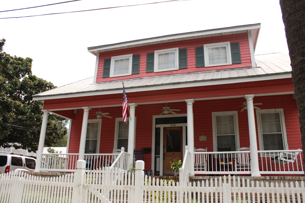 "The Kennedy House with its ""high-spirited"" porch"