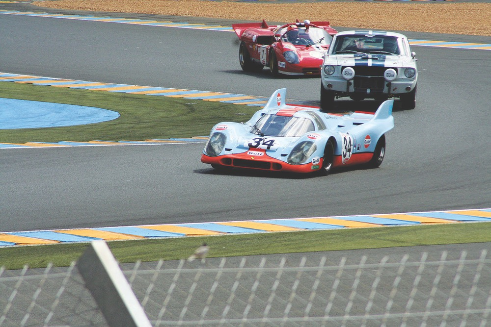 A 1970 Ferrari 512 S with a 1966 Shelby Mustang GT350 and a 1971 Porsche 917 in hot pursuit