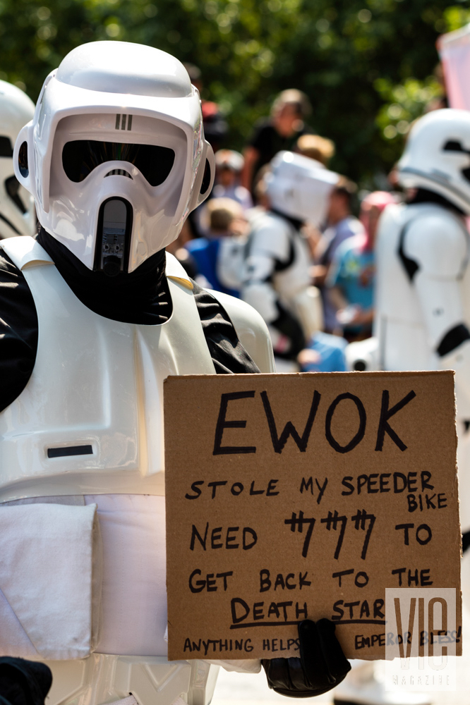 Storm Trooper with sign at Dragon Con
