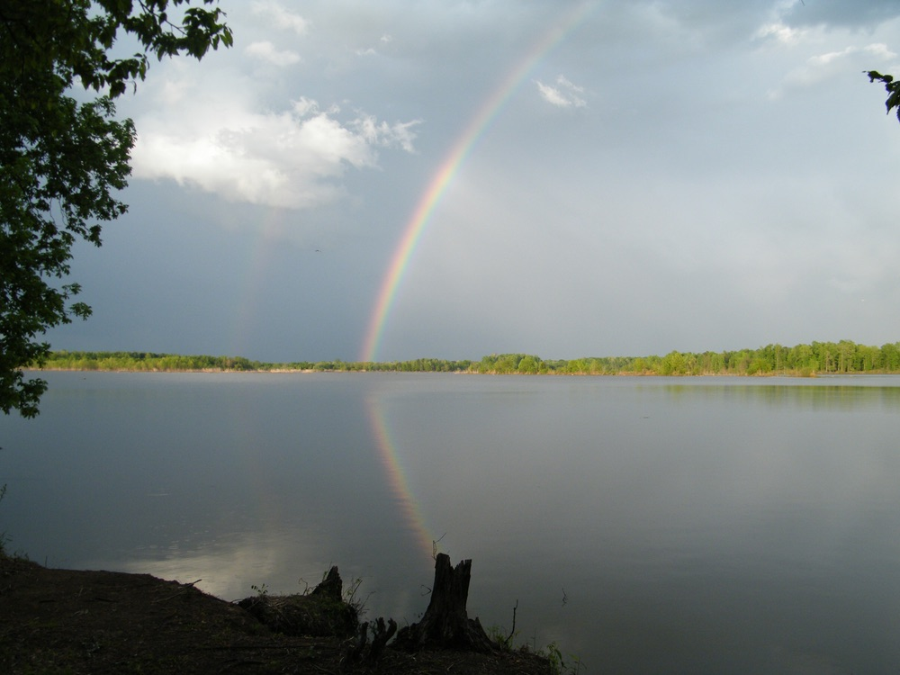 Rainbow over a lake pilgrimage journey without reservations pat crawford