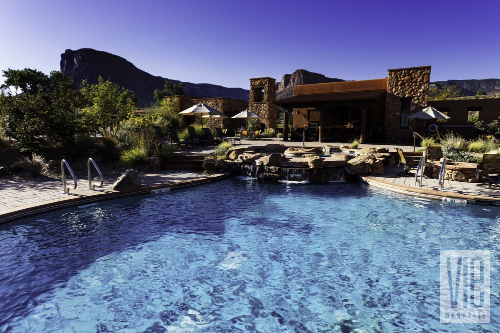 An Outdoor Pool With A Backdrop Of The Colorado Canyons At The Gateway Canyons Resort And Spa