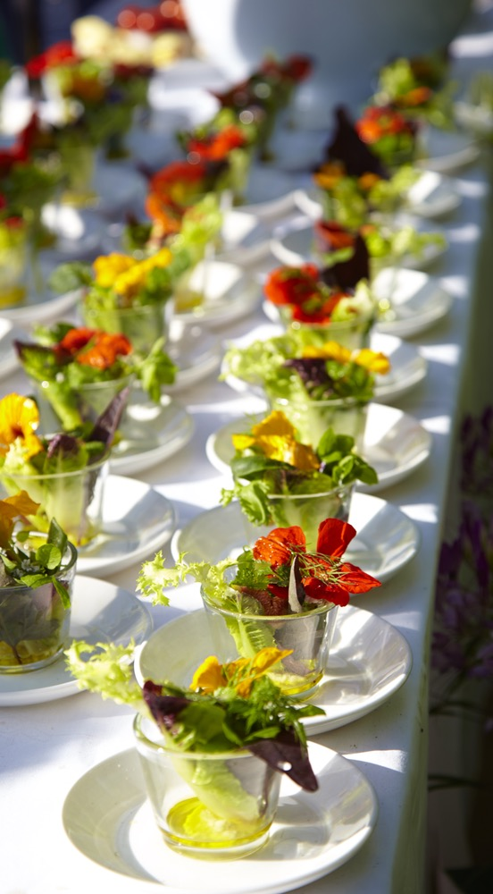 Small Cups Of Salad Appetizers With Edible Flower Garnish