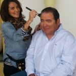 "Makeup artist Yvette Nation prepares Emeril for his ""close-up."""