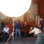 Photographer Romona Robbins uses husband Shane Reynolds (seated) and team as test shots for the cover shoot.