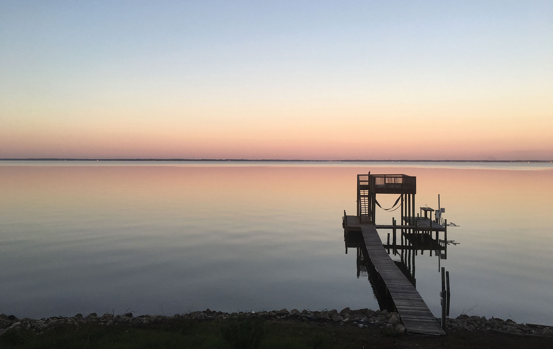 View of the dock and sunset on Florida's Choctawhatchee bay