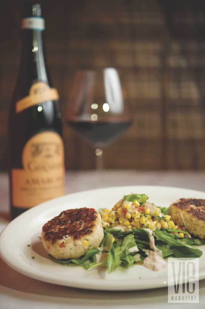 Festive Scallop Dish Served On A Bed Of Greens And Corn Salad