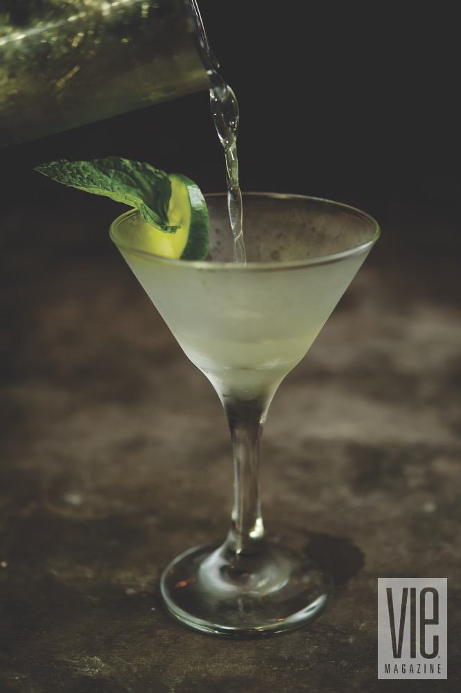 A Chilled Martini With Mint Garnish And A Lime Wedge