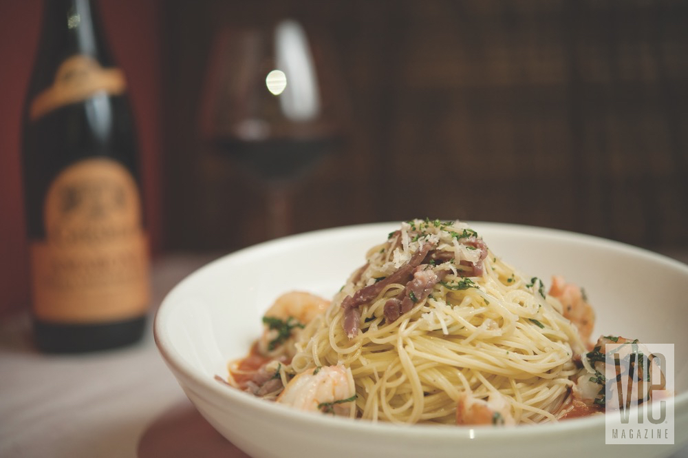 Seafood Angelhair Pasta From Borago Is Garnished With Parsley And Freshly Grated Parmesan Cheese