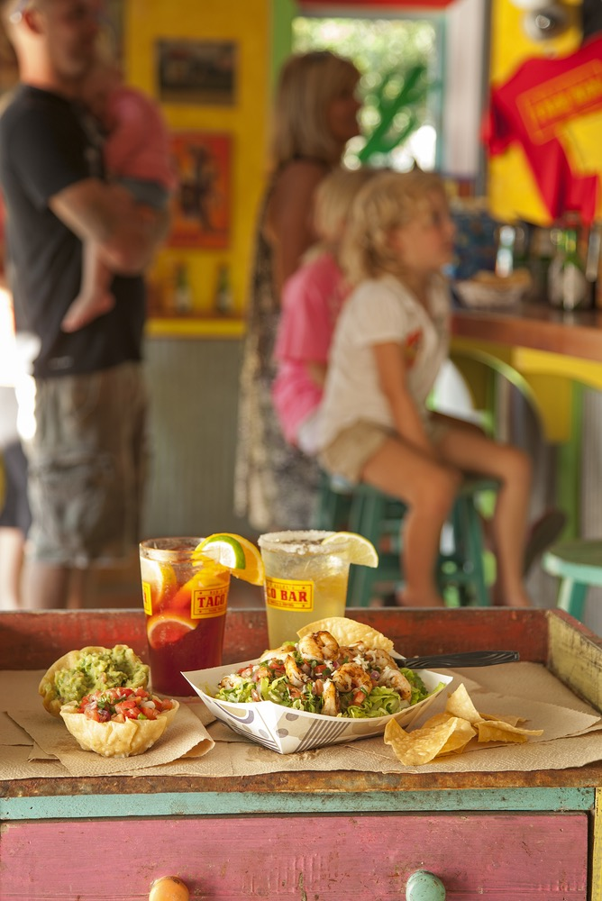 White Fish Tacos Packed With Flavor and Dressed With A Zesty Topping Are Served With Ice Cold Drinks