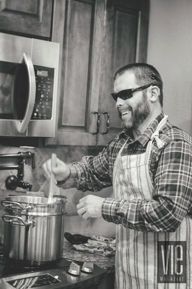 Retired Army Staff Sergeant Aaron Hale In His Kitchen Stirring Together Fudge