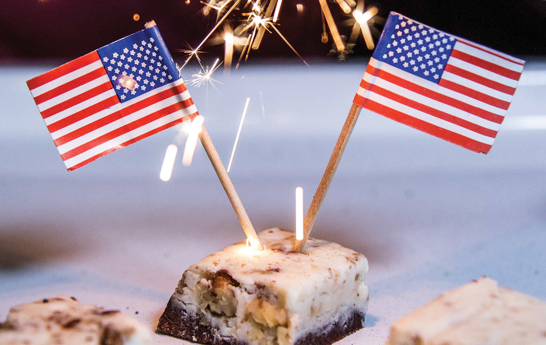Cookies And Cream EOD Fudge With Two Mirrored American Flags And A Sparkler Background