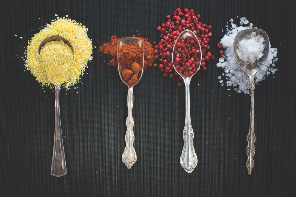 Spoons of Vibrant Colored Spices Are Used To Illustrate the Flavors Used Injected in Cuisine
