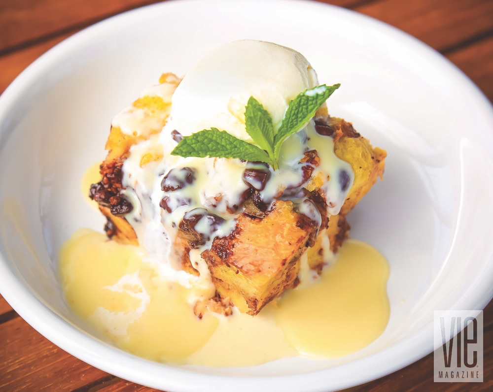 Dark Chocolate Bread Pudding With Whiskey Sauce Garnished With A Mint By Bud And Alleys Restaurant