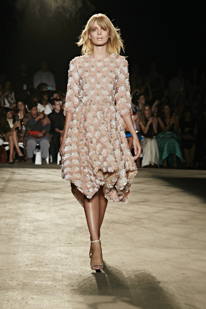 New York Fashion Week Model In A Mid Length Dress Fully Beaded With Colors Of Blush Nude And Gold