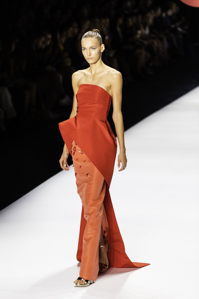 New York Fashion Week 2016 Model Walking Down The Runway in A Cherry Red Monique Lhuillier Evening Dress