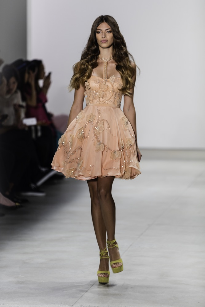 New York Fashion Week Model In Sherbet Colored Fit And Flare Dress Designed By Idan Cohen