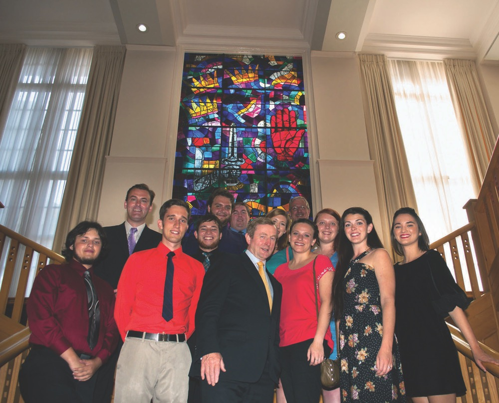 UWF Irish Experiece Program Students Gathered In A Group Picture In Front Of A Vibrant Glass Stained Window