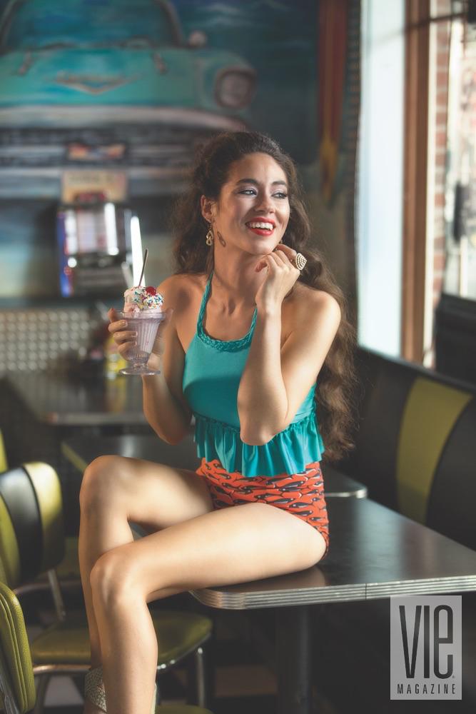 Stunning model Piper Williams enjoying an ice cream sundae in Cayce Collins swimwear