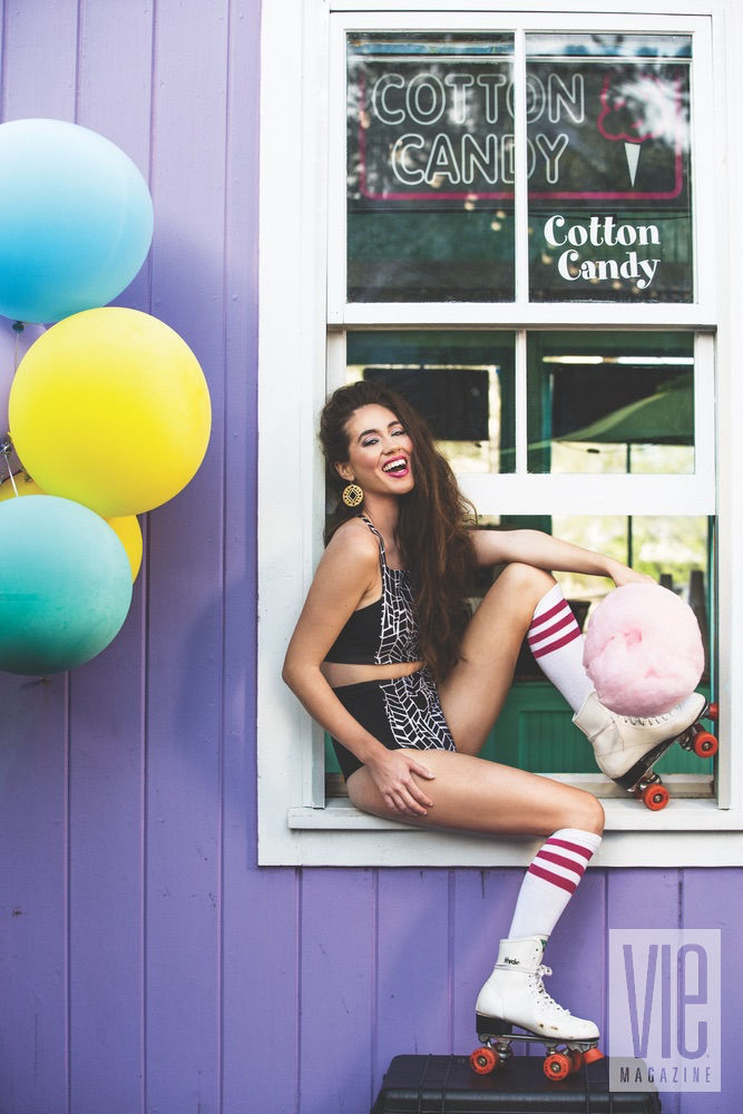 Gorgeous model Piper Williams eating cotton candy and wearing roller blades