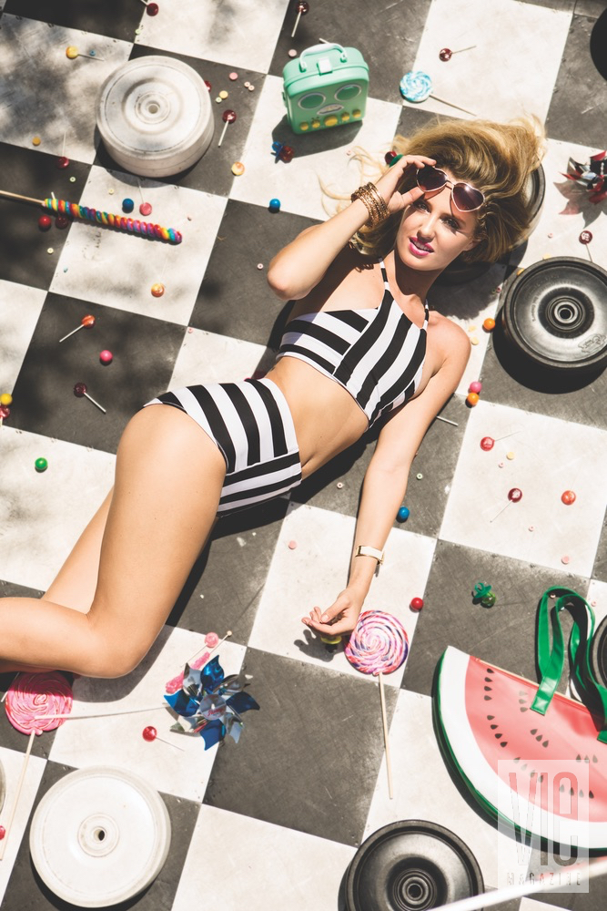 Cover model Emme Martin in Cayce Collins swimsuit on checkerboard in Baytowne Wharf