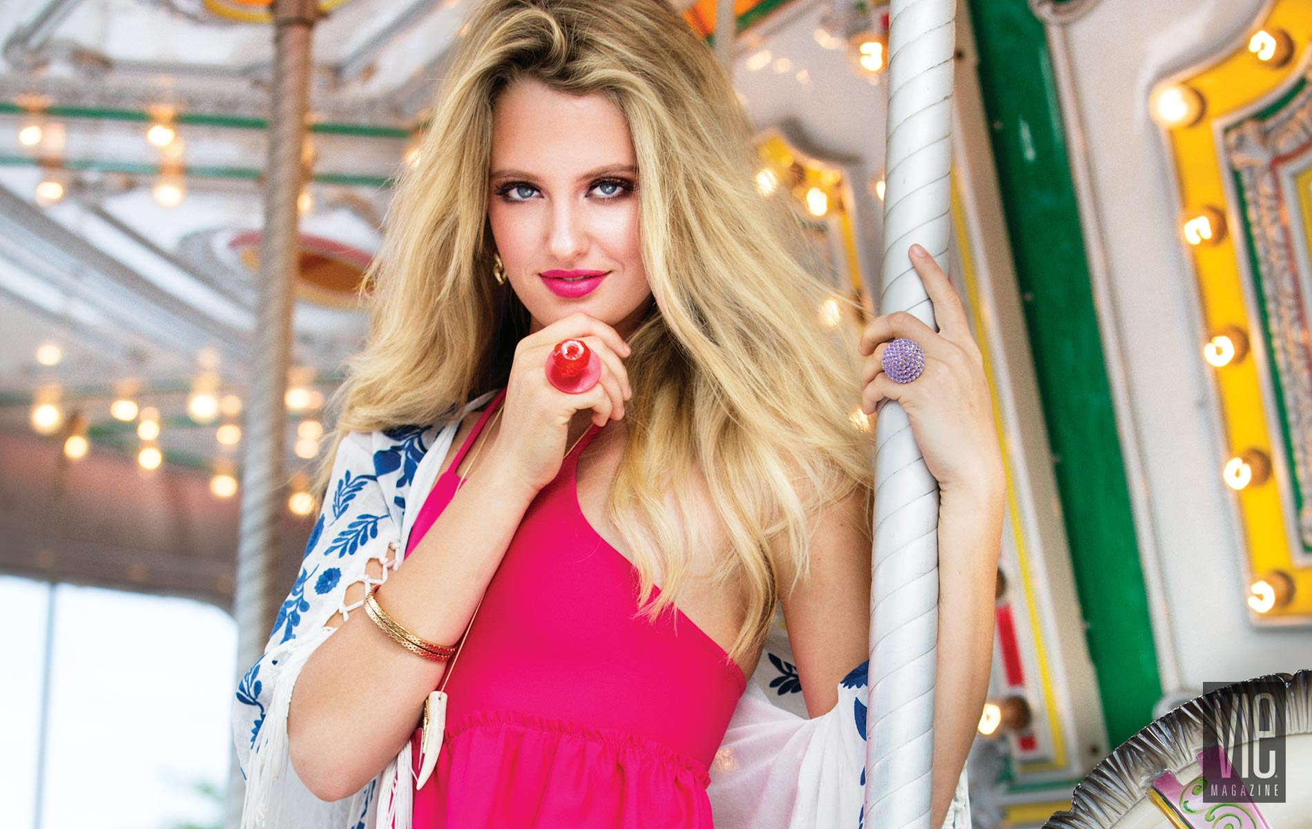 Emme Martin wearing a Cayce Collins Swimsuit on a carousel in Baytowne Wharf