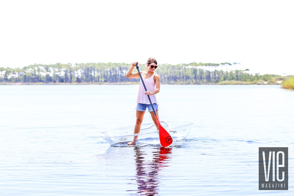 Model standup paddleboarding in a Klear Kanoo on Western Lake