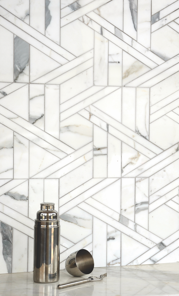 Hector Grand, a stone waterjet mosaic, shown in Calacatta Tia honed, is part of the Altimetry Collection for New Ravenna