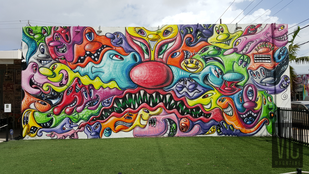 Mural painting on side of wall Wynwood Walls Miami Florida grafitti street art colorful abstract